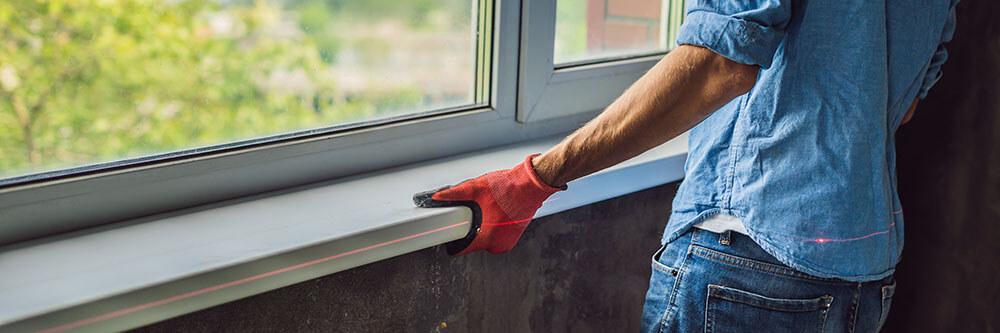 Man does window installation