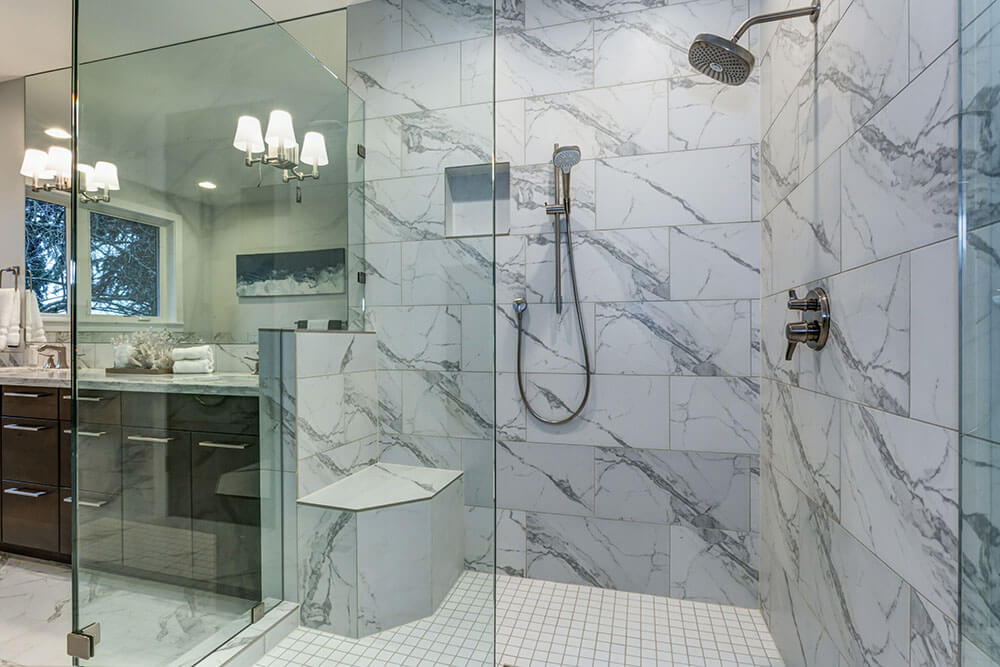 Master bathroom with modern glass walk in shower