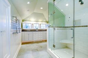White luxury bathroom with glass shower door