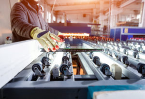Window pane coming off conveyor belt for glass manufacturing