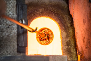Superheated blown glass piece coming out of a furnace in Murano, Italy