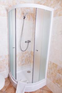 Round shower door made of glass