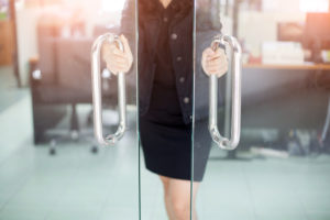 woman's hands opening glass doors